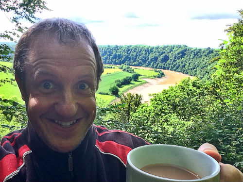 Christopher Fielden with a cup of tea in the Wye Valley near Tintern